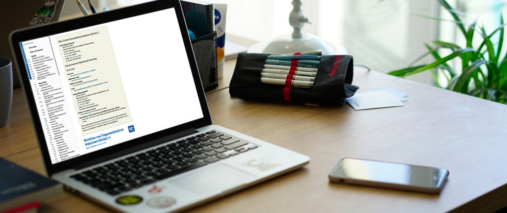 Laptop met WCAG 2.1 Nederlandse vertaling